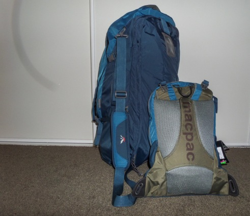 Macpac Orient Express 65, Pack straps stowed, shoulder sling shown, daypack with straps stowed